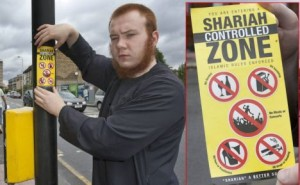 PIC BY DAVID NEW-8/7/2011-JAMAAL UDDIN OF 'MUSLIMS AGAINST CRUSADES' DECLARES A PART OF LEYTON UNDER 'SHARIAH LAW'. BEHIND HIM IS THE DEFUNCT OLIVER TWIST PUB, MUSLIMS BEING AGAINST ALCOHOL CONSUMPTION.