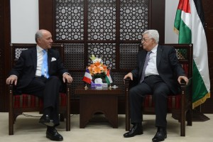 epa04813303 A handout photograph supplied by the Palestinian Authority shows French Foreign Minister Laurent Fabius (L) as he is greeted by Palestinian President Mahmoud Abbas (R), in the 'Muqata' or Palestinian Authority headquarters, in the West Bank town of Ramallah, 21 June 2015. Fabius, during a visit to Cairo earlier in the week, urged the resumption of Middle East peace talks, while warning that continued Israeli settlement building on land the Palestinians want for a future state would damage chances of a final deal. EPA/THAER GANAIM / HANDOUT HANDOUT EDITORIAL USE ONLY/NO SALES